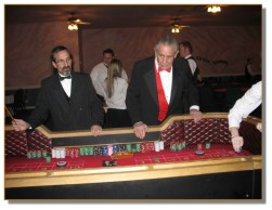 Two of our handsome craps dealers in action