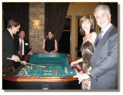 Guests enjoying a game of craps at a recent party